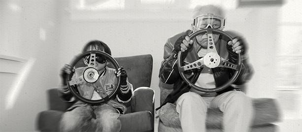 Grandfather and grandson pretend driving
